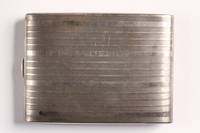 2003.149.85 back Felmore Art Deco cigarette case owned by German Jewish emigre and US soldier  Click to enlarge