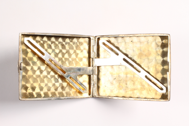 2003.149.85 open Felmore Art Deco cigarette case owned by German Jewish emigre and US soldier