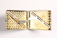 2003.149.85 open Felmore Art Deco cigarette case owned by German Jewish emigre and US soldier  Click to enlarge