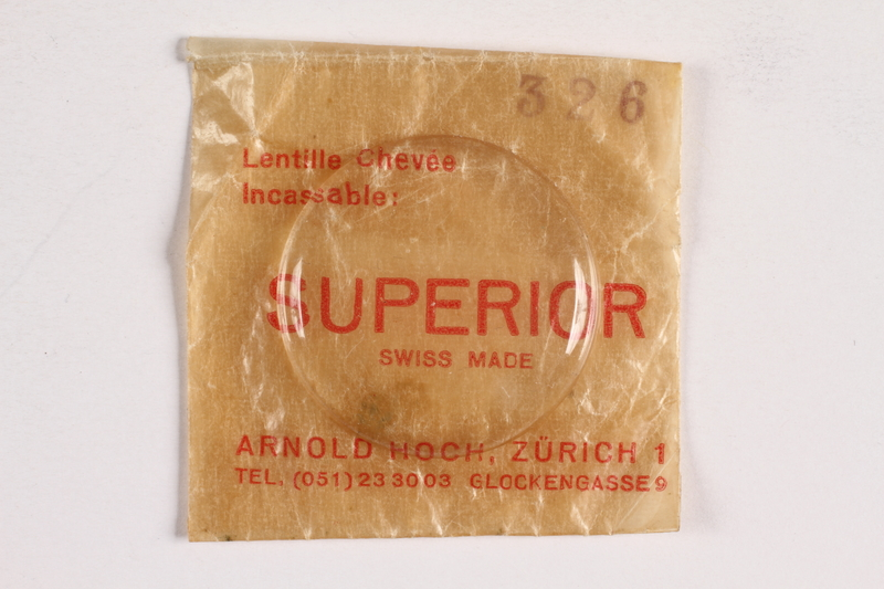 2003.149.89_a-b front Replacement watch crystal in packaging owned by German Jewish US soldier