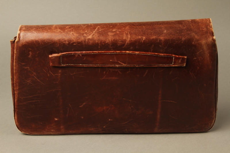 2016.151.2 back Brown leather satchel used by a Polish Jewish prisoner
