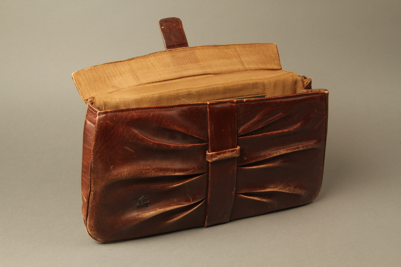2016.151.2 open Brown leather satchel used by a Polish Jewish prisoner