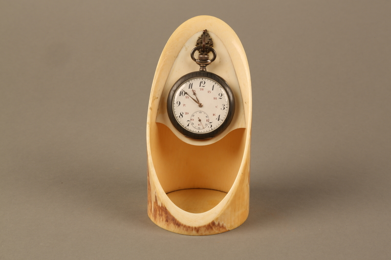 2016.137.5_a-b front Pocket watch with stand used by a Polish Jewish man while living in hiding