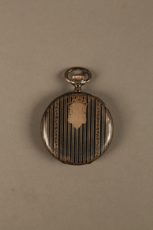 2016.137.5_a back Pocket watch with stand used by a Polish Jewish man while living in hiding