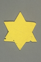 2016.458.3 front Unused yellow felt Star of David badge  Click to enlarge