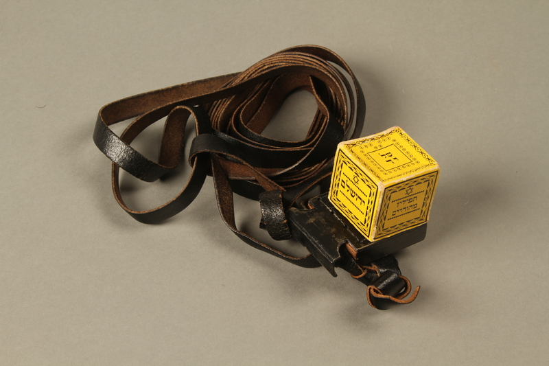 2016.280.1_a-b 3/4 view closed Pair of tefillin and pouch owned by a Polish Jewish immigrant