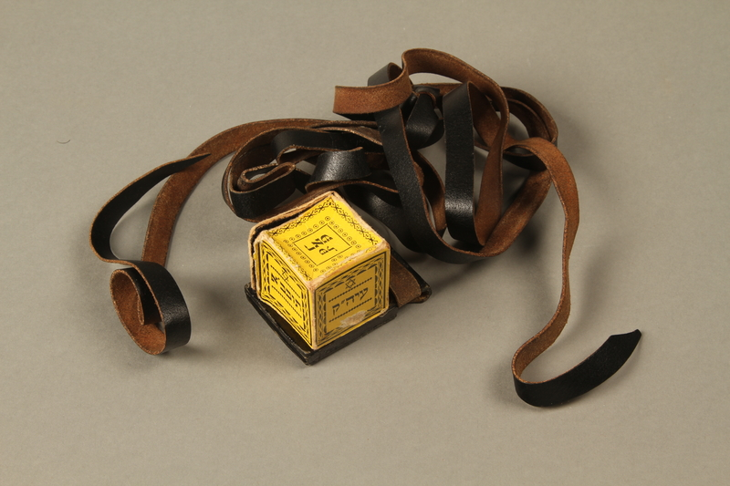 2016.280.1_c-d 3/4 view closed Pair of tefillin and pouch owned by a Polish Jewish immigrant