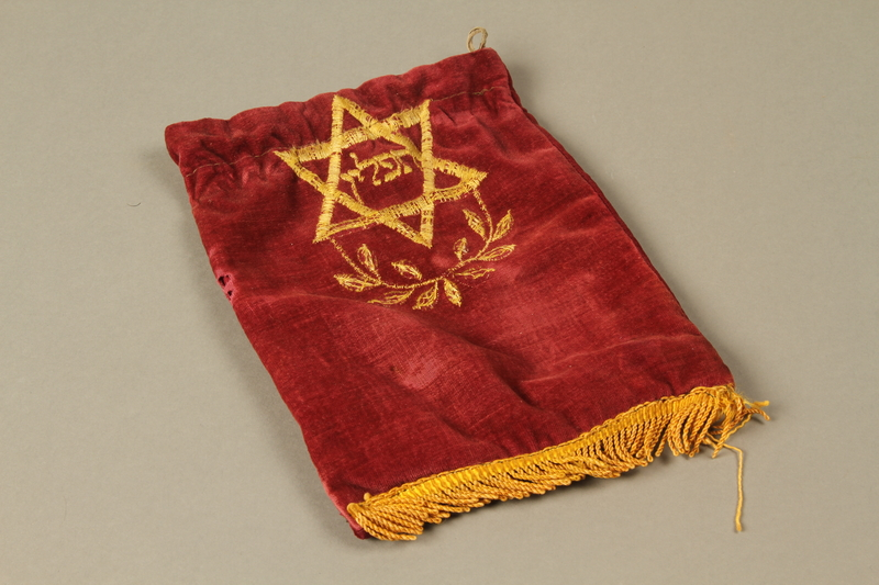 2016.280.1_e 3/4 view Pair of tefillin and pouch owned by a Polish Jewish immigrant