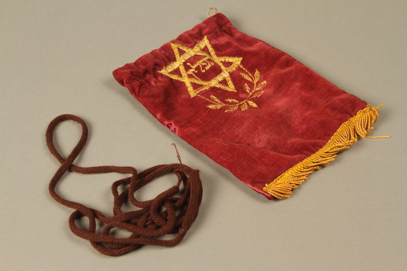 2016.280.1_e-f 3/4 view Pair of tefillin and pouch owned by a Polish Jewish immigrant