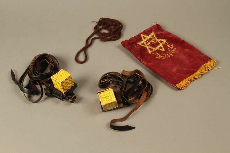 2016.280.1_a-f 3/4 view Pair of tefillin and pouch owned by a Polish Jewish immigrant