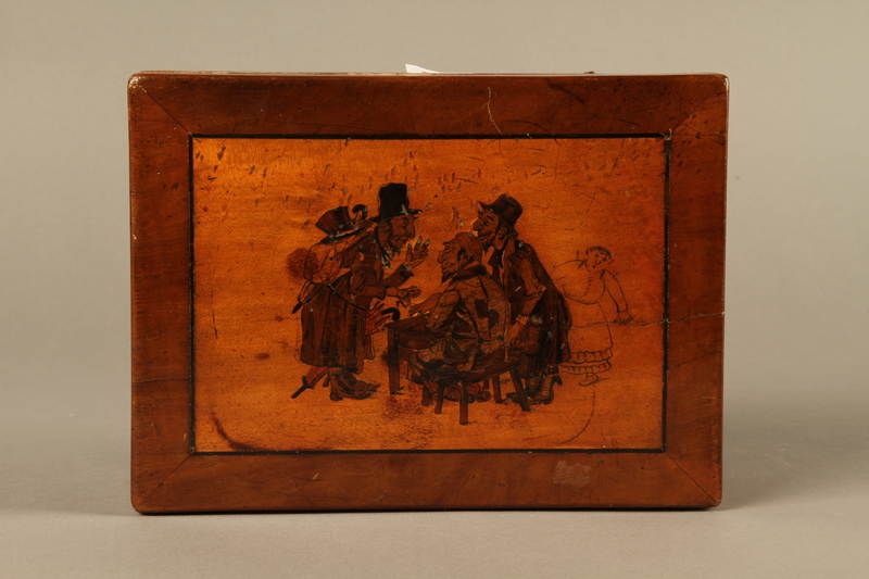 2016.184.532 top Wooden cigar box with an image of gossiping, stereotypical Jewish peddlers