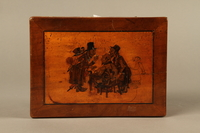 2016.184.532 top Wooden cigar box with an image of gossiping, stereotypical Jewish peddlers  Click to enlarge