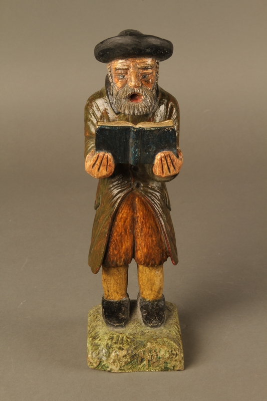 2016.184.533 front Painted wooden figure of a Jewish man praying and holding a book
