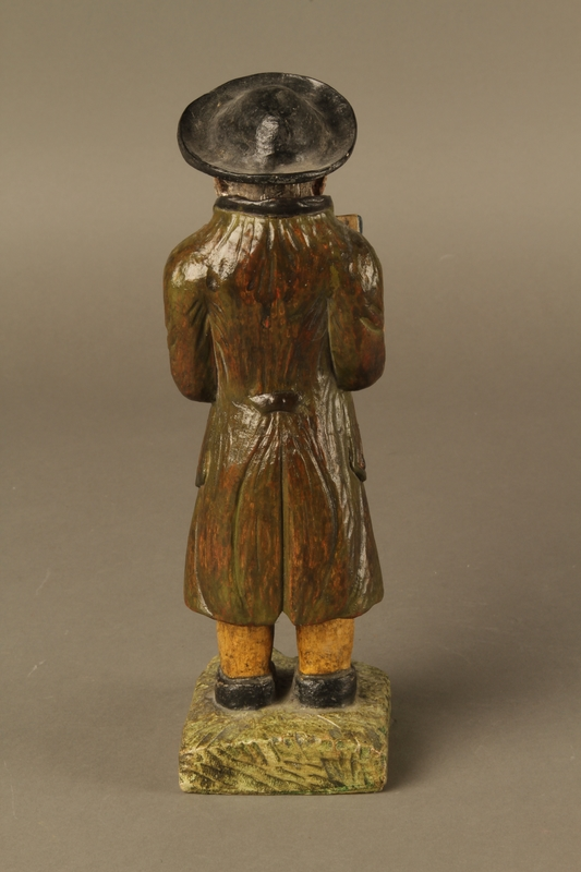2016.184.533 back Painted wooden figure of a Jewish man praying and holding a book