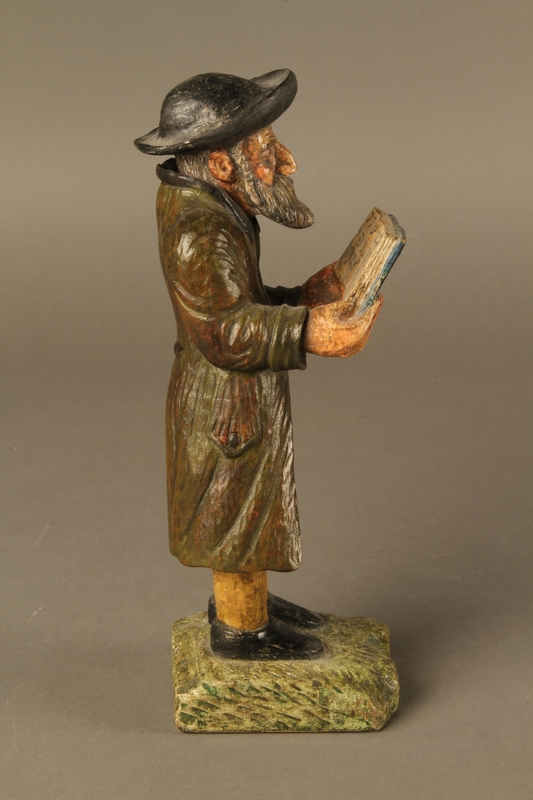 2016.184.533 right side Painted wooden figure of a Jewish man praying and holding a book