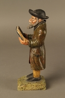 2016.184.533 left side Painted wooden figure of a Jewish man praying and holding a book  Click to enlarge