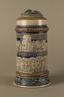 2016.184.535 front Gray and blue beer stein with images of anti-Jewish fables and politicians  Click to enlarge