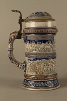 2016.184.535 right side Gray and blue beer stein with images of anti-Jewish fables and politicians  Click to enlarge