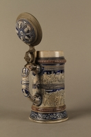 2016.184.535 open 3/4 view Gray and blue beer stein with images of anti-Jewish fables and politicians  Click to enlarge