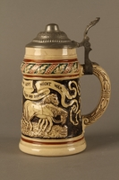 2016.184.536 left side Black and cream ceramic beer stein with Jewish usurers tormenting a German farmer  Click to enlarge