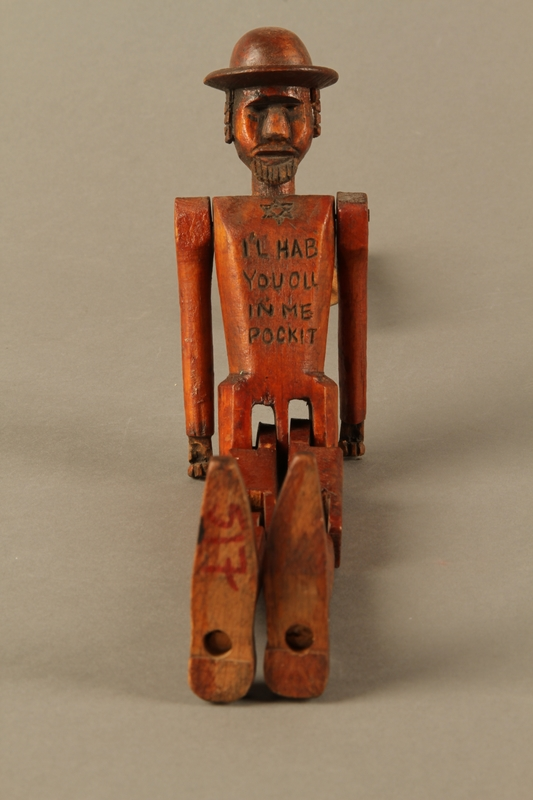 2016.184.564 front Jointed wooden rod puppet shaped as a Jewish man with a Star of David badge