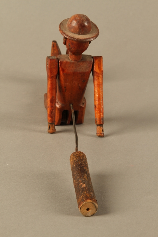 2016.184.564 back Jointed wooden rod puppet shaped as a Jewish man with a Star of David badge