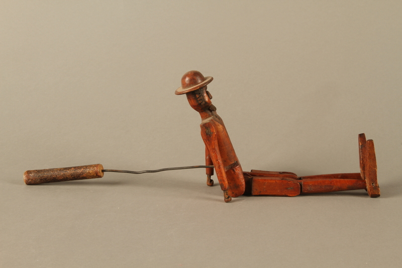 2016.184.564 right side Jointed wooden rod puppet shaped as a Jewish man with a Star of David badge