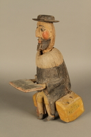 2016.184.566 a-b 3/4 view Hand crafted wooden pull toy of a Jewish man praying  Click to enlarge