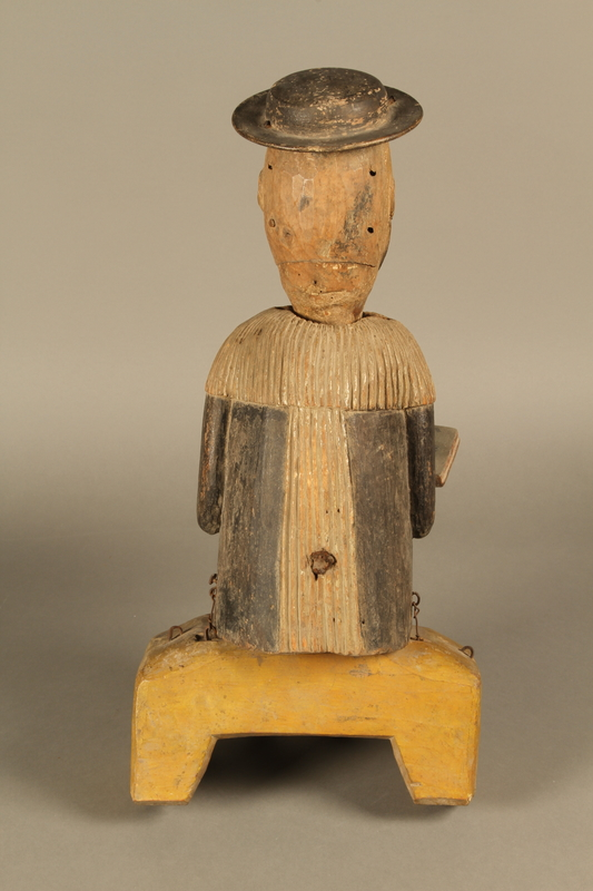 2016.184.566 a-b back Hand crafted wooden pull toy of a Jewish man praying