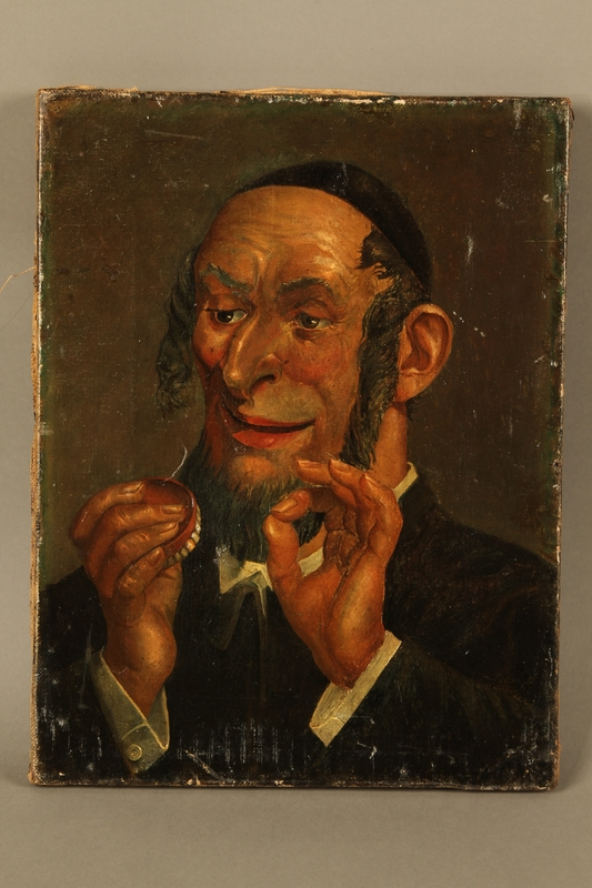 2016.184.568 front Portrait of a Jewish man smiling at a denture with a gold tooth
