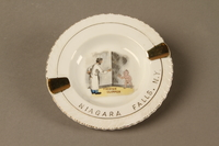 2016.184.574 front Souvenir ashtray of the Yiddish clipper, a man with scissors and a naked boy  Click to enlarge