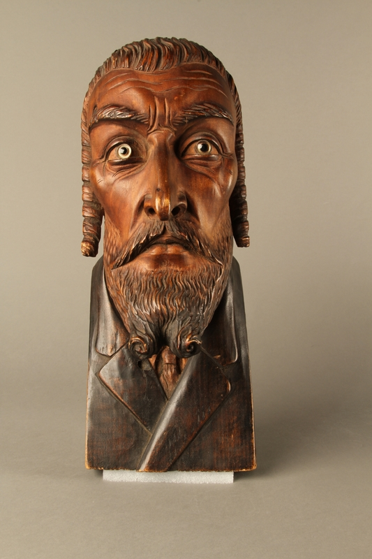 2016.184.576 front Wooden carving of the head of a Jewish man