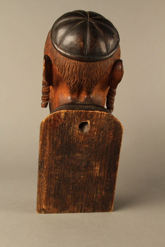 2016.184.576 back Wooden carving of the head of a Jewish man