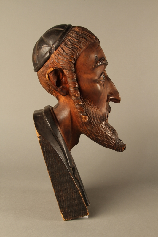 2016.184.576 right side Wooden carving of the head of a Jewish man
