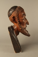 2016.184.576 right side Wooden carving of the head of a Jewish man  Click to enlarge