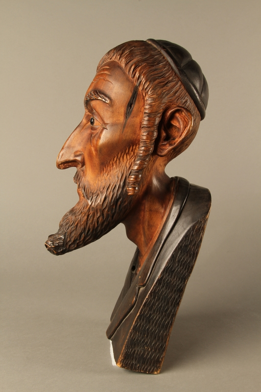 2016.184.576 left side Wooden carving of the head of a Jewish man