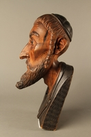 2016.184.576 left side Wooden carving of the head of a Jewish man  Click to enlarge