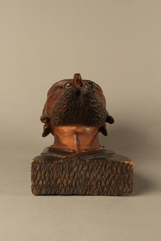 2016.184.576 bottom Wooden carving of the head of a Jewish man