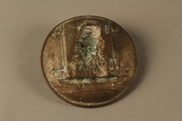 2016.184.587 back Bronze metal dish of a Jewish peddler at an open window  Click to enlarge