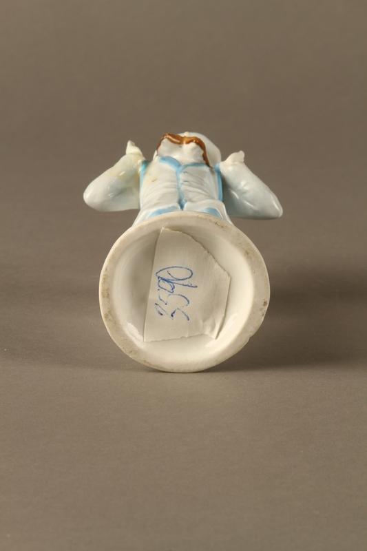 2016.184.589.1 bottom Porcelain match holder shaped as a Jewish peddler