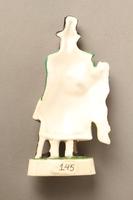 2016.184.593 back Porcelain figurine of a Jewish ribbon peddler in a green coat  Click to enlarge