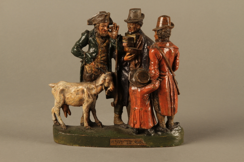 2016.184.594 front Colorful terracotta figure group of 3 Jewish men, a boy, and a goat