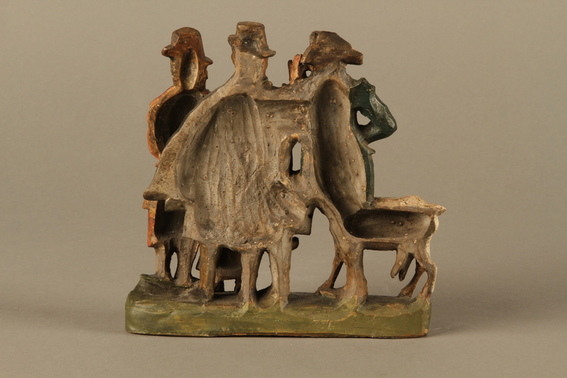 2016.184.594 back Colorful terracotta figure group of 3 Jewish men, a boy, and a goat