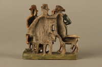 2016.184.594 back Colorful terracotta figure group of 3 Jewish men, a boy, and a goat  Click to enlarge