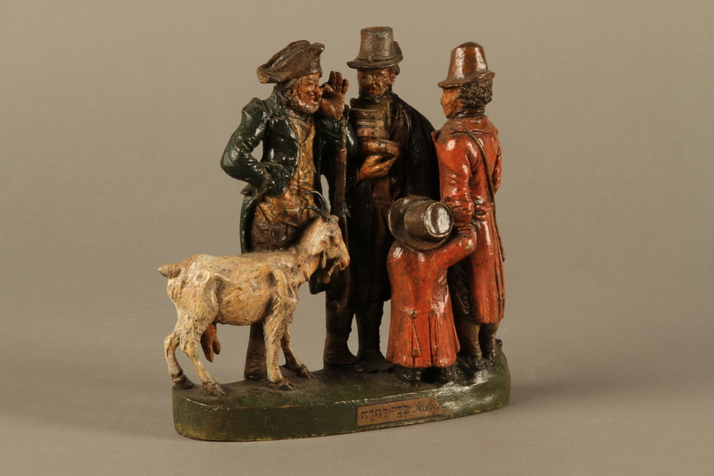 2016.184.594 left side Colorful terracotta figure group of 3 Jewish men, a boy, and a goat