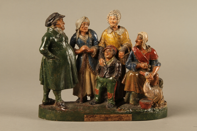 2016.184.595 front Colorful terracotta figure group of a Jewish family dressed for Sabbath