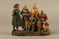 2016.184.595 front Colorful terracotta figure group of a Jewish family dressed for Sabbath  Click to enlarge