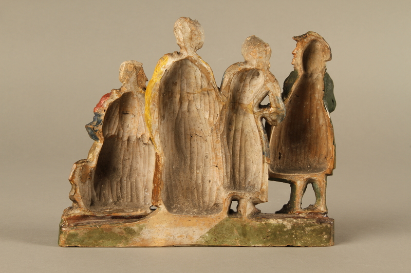 2016.184.595 back Colorful terracotta figure group of a Jewish family dressed for Sabbath
