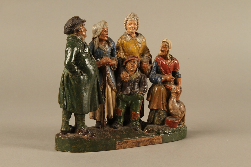 2016.184.595 right side Colorful terracotta figure group of a Jewish family dressed for Sabbath
