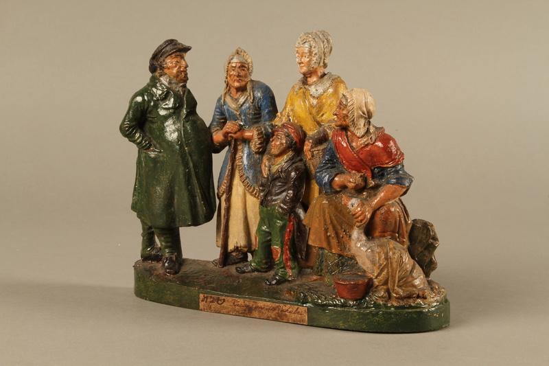 2016.184.595 left side Colorful terracotta figure group of a Jewish family dressed for Sabbath